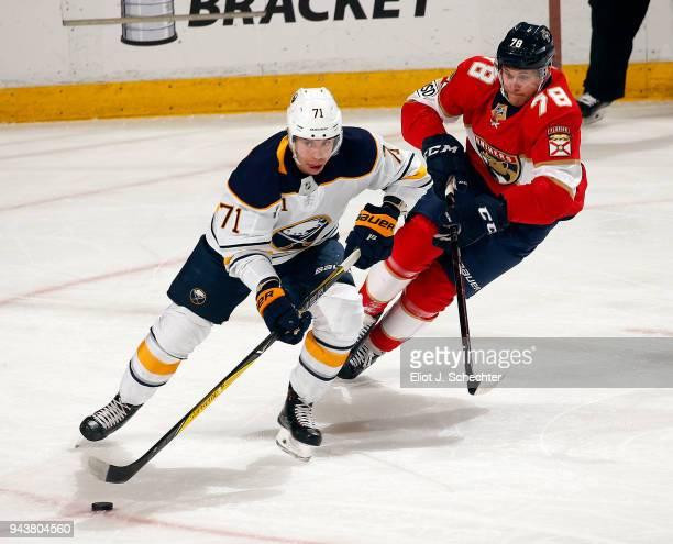 Evan Rodrigues of the Buffalo Sabres skates with the puck against Maxim Mamin of the Florida Panthers at the BBT Center on April 7 2018 in Sunrise...