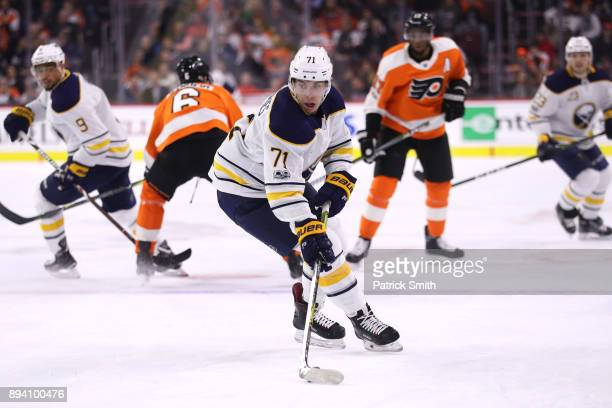 Evan Rodrigues of the Buffalo Sabres skates with the puck against the Philadelphia Flyers during the first period at Wells Fargo Center on December...