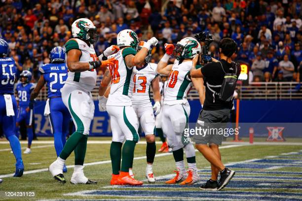 Evan Rodriguez and Kenneth Farrow of the Seattle Dragons celebrate after a touchdown during the XFL game against the St. Louis BattleHawks at The...