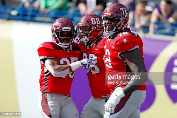 Evan Rodriguez of the San Antonio Commanders is congratulated by his teammates Trey Williams and Jaryd JonesSmith after a touchdown reception against...