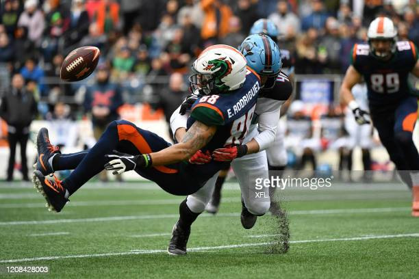 Evan Rodriguez of the Seattle Dragons takes a hit from Greer Martini of the Dallas Renegades during the XFL game at CenturyLink Field on February 22,...