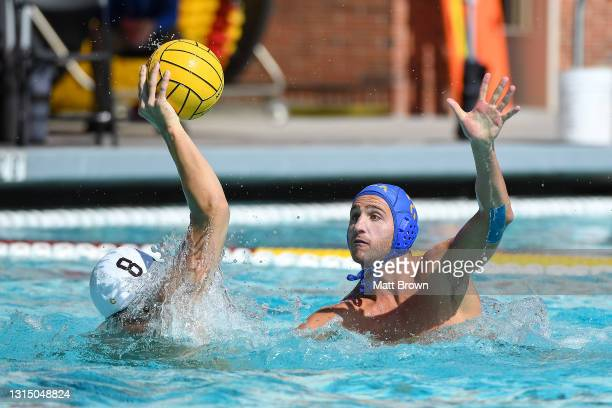 Evan Rosenfeld of the UCLA Bruins defends Jake Ehrhardt of the USC Trojans during the Division I Men's Water Polo Championship held at the Uytengsu...