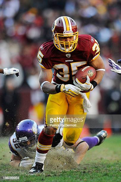 Evan Royster of the Washington Redskins runs the ball against the Minnesota Vikings at FedExField on December 24 2011 in Landover Maryland