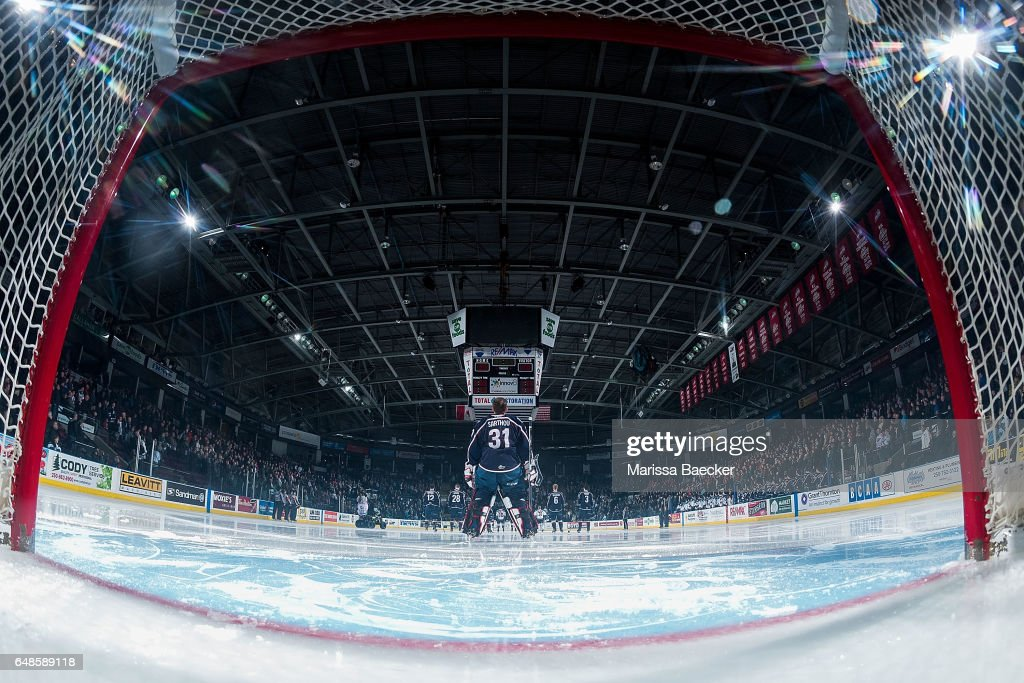 Evan Sarthou #31 of the Tri-City Americans stands on the ice during the national anthem against the Kelowna Rockets on March 4, 2017 at Prospera Place in Kelowna, British Columbia, Canada.