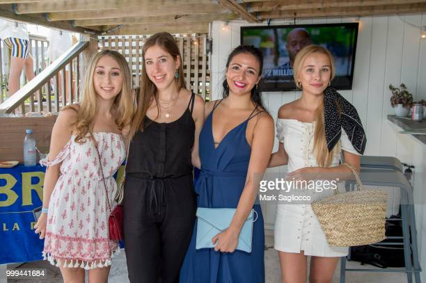Evan Silvera Ellie Rakower Erica Commisso and Polina Meshkova attend the Modern Luxury The Next Wave at Breakers Montauk on July 14 2018 in Montauk...