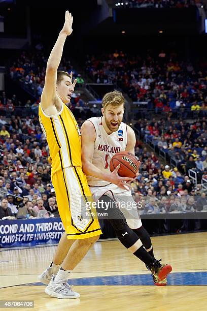 Evan Smotrycz of the Maryland Terrapins drives against Alec Peters of the Valparaiso Crusaders during the second round of the Men's NCAA Basketball...
