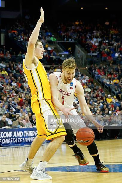 Evan Smotrycz of the Maryland Terrapins drives against Alec Peters of the Valparaiso Crusaders during the second round of the 2015 NCAA Men's...