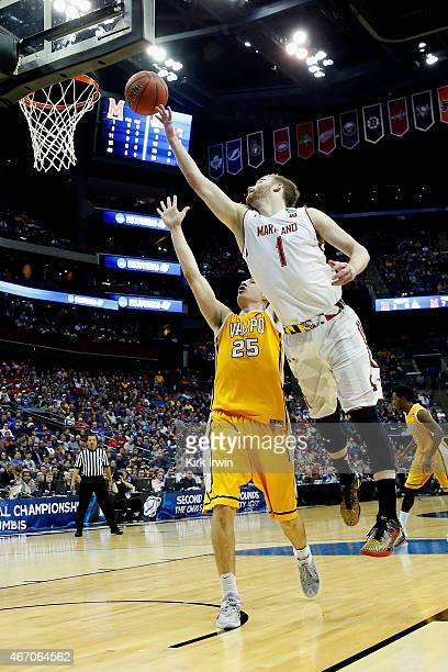 Evan Smotrycz of the Maryland Terrapins takes a shot over Alec Peters of the Valparaiso Crusaders during the second round of the Men's NCAA...
