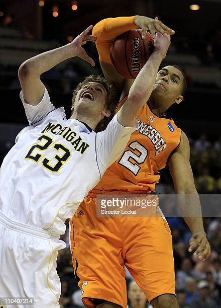 Evan Smotrycz of the Michigan Wolverines and Tobias Harris of the Tennessee Volunteers battle for the ball in the first half during the second round...