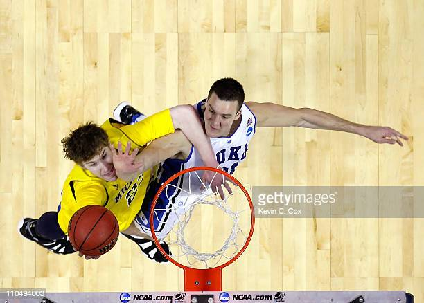 Evan Smotrycz of the Michigan Wolverines goes up for a layup against Miles Plumlee of the Duke Blue Devils during the third round of the 2011 NCAA...
