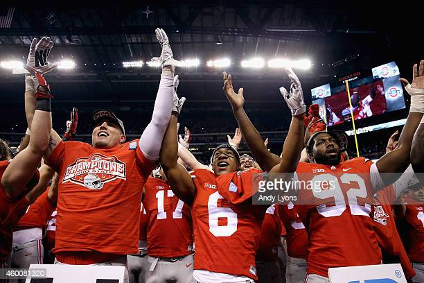 Evan Spencer Adolphus Washington and the Ohio State Buckeyes celebrate after they defeated the Wisconsin Badgers 590 in the Big Ten Championship at...