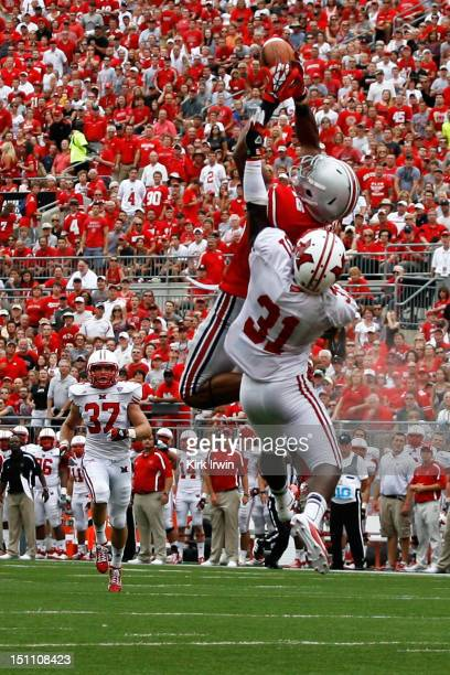 Evan Spencer of the Ohio State Buckeyes catches a pass over Chrishawn Dupuy of the Miami Redhawks during the second quarter on September 1 2012 at...