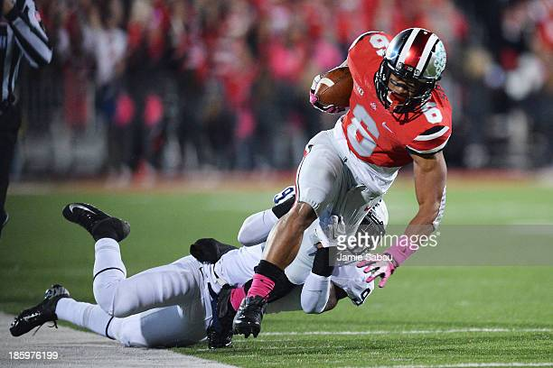 Evan Spencer of the Ohio State Buckeyes is brought down by Jordan Lucas of the Penn State Nittany Lions after a 20yard pass reception in the second...