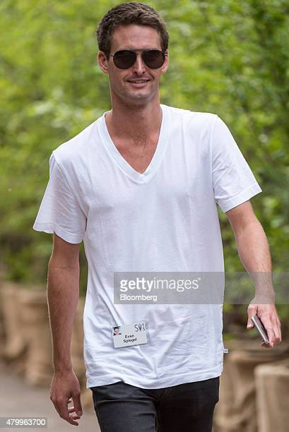 Evan Spiegel cofounder and chief executive officer of Snapchat Inc walks the grounds after a morning session during the Allen Co Media and Technology...