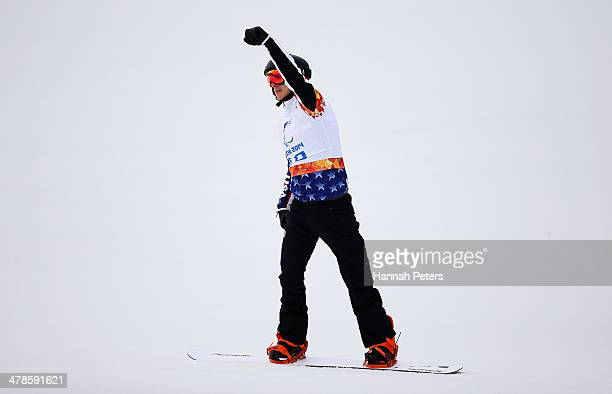 Evan Strong of the United States celebrates during the Men's Para Snowboard Cross Standing on day seven of the Sochi 2014 Paralympic Winter Games at...