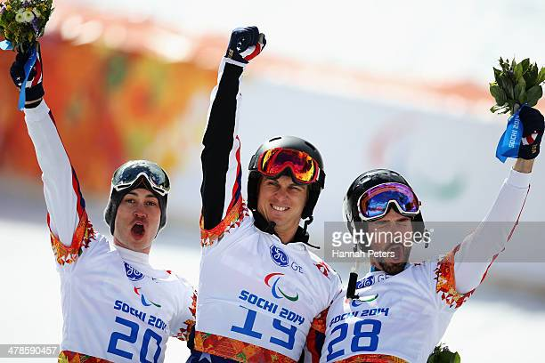 Evan Strong of the United States celebrates winning the gold medal with silver medalist Michael Shea of the United States and bronze medalist Keith...