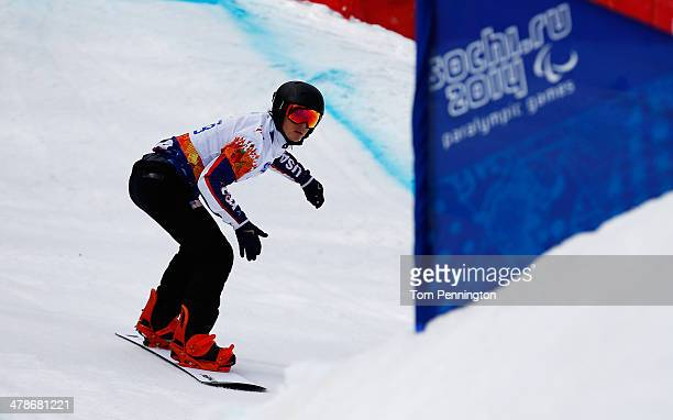 Evan Strong of the United States competes during the Men's Para Snowboard Cross Standing on day seven of the Sochi 2014 Paralympic Winter Games at...