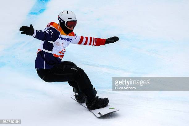 Evan Strong of the United States competes during the Men's snowboard Slalom SBLL2 during day seven of the PyeongChang 2018 Paralympic Games on March...