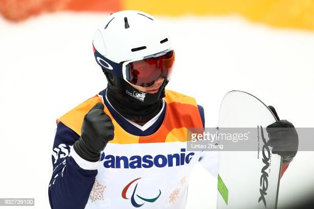 Evan Strong of the United States reacts after competes in the Men's Banked Slalom SBUL Run 3 during day seven of the PyeongChang 2018 Paralympic...