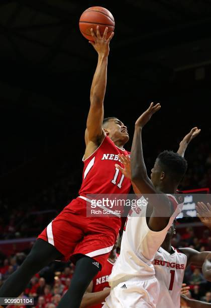 Evan Taylor of the Nebraska Cornhuskers attempts a shot as Issa Thiam of the Rutgers Scarlet Knights defends during the second half of a game at...
