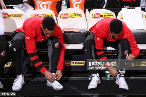 Evan Turner and CJ McCollum of the Portland Trail Blazers tie their shoes before the game against the Memphis Grizzlies on January 27 2017 at the...