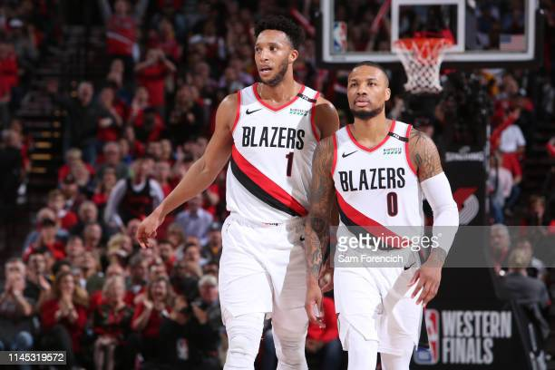 Evan Turner and Damian Lillard of the Portland Trail Blazers look on during Game Four of the Western Conference Finals against the Golden State...