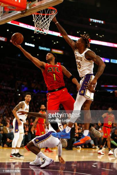 Evan Turner of the Atlanta Hawks goes up for a shot as he's guarded by Dwight Howard of the Los Angeles Lakers during the first half of a game at...