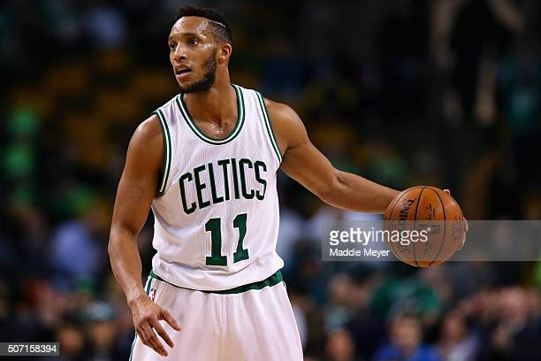Evan Turner of the Boston Celtics carries the ball against the Denver Nuggets during the fourth quarter at TD Garden on January 27 2016 in Boston...