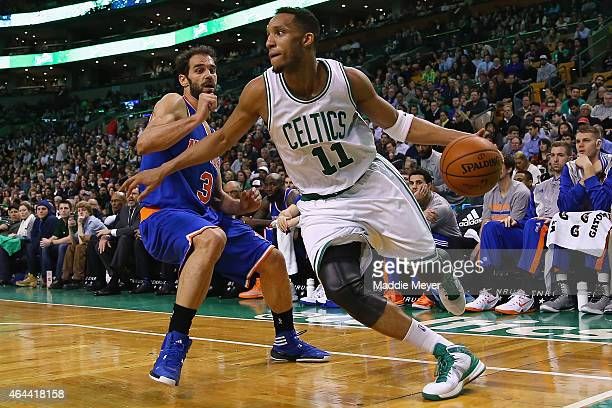 Evan Turner of the Boston Celtics drives past Jose Calderon of the New York Knicks during the third quarter at TD Garden on February 25 2015 in...