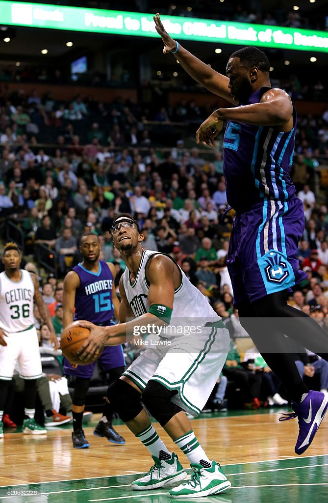 Evan Turner #11 of the Boston Celtics goes up with the ball against Al Jefferson #25 of the Charlotte Hornets in the fourth quarter at TD Garden on April 11, 2016 in Boston, Massachusetts.