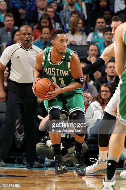 Evan Turner of the Boston Celtics handles the ball during the game against the Charlotte Hornets on December 23 2015 at Time Warner Cable Arena in...