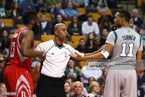 Evan Turner of the Boston Celtics is separated from James Harden of the Houston Rockets after a technical foul is called against him during the...