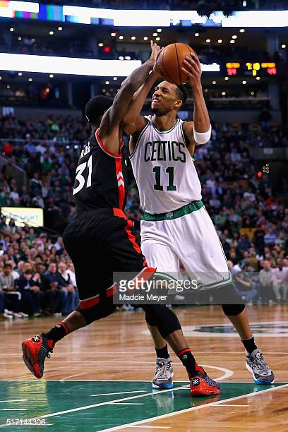 Evan Turner of the Boston Celtics looks for a shot against Terrence Ross of the Toronto Raptors during the third quarter at TD Garden on March 23...