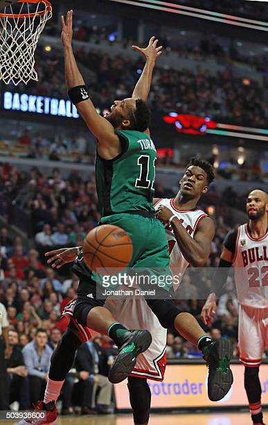 Evan Turner of the Boston Celtics looses control of the ball after it was knocked away by Jimmy Butler of the Chicago Bulls at the United Center on...