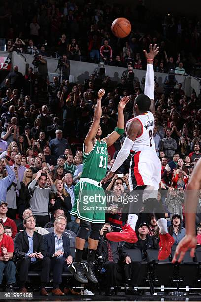 Evan Turner of the Boston Celtics takes the game winning shot against the Portland Trail Blazers on January 22 2015 at the Moda Center in Portland...