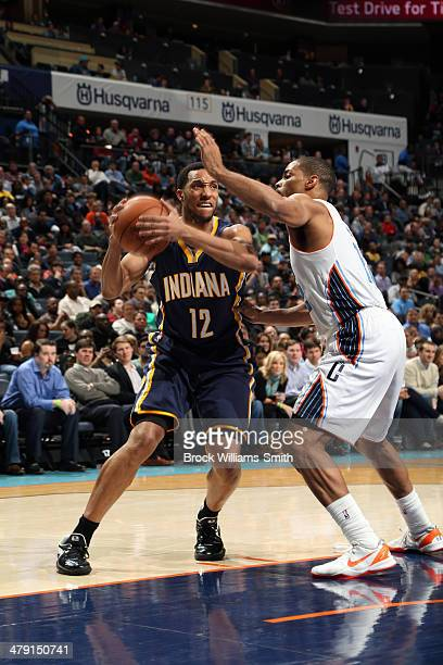 Evan Turner of the Indiana Pacers drives to the basket against the Charlotte Bobcats at the Time Warner Cable Arena on March 5 2014 in Charlotte...