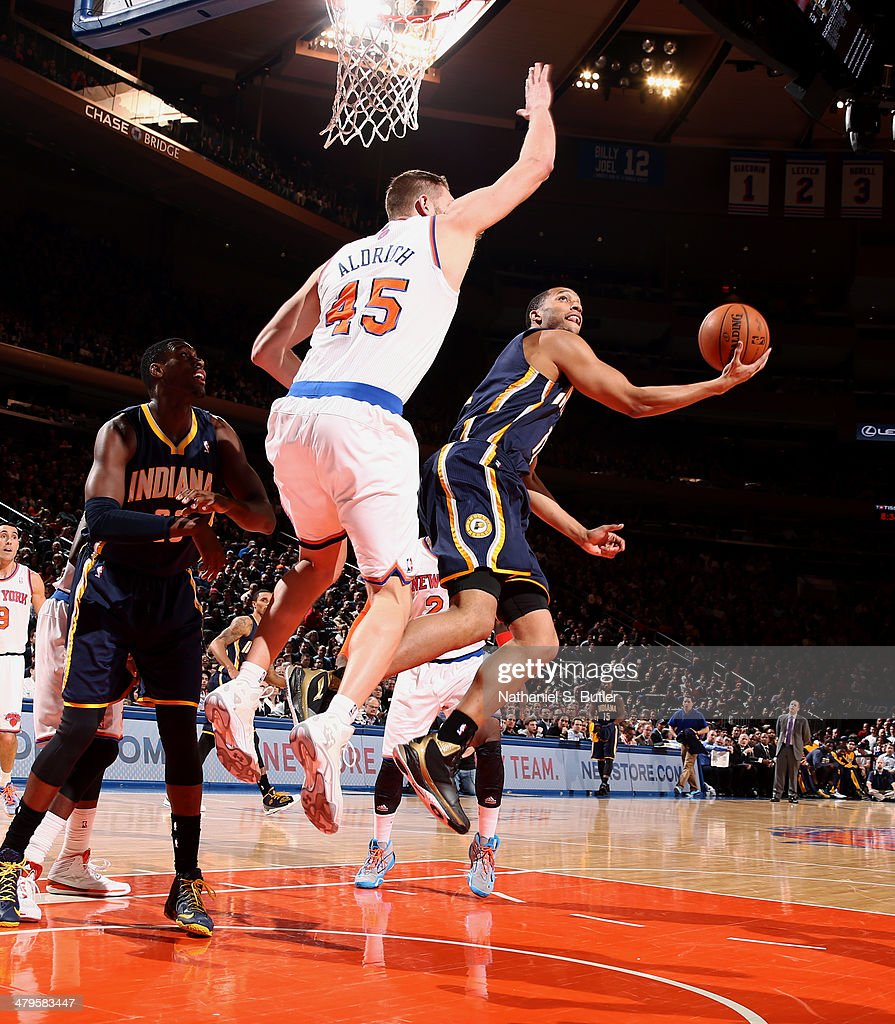 Evan Turner #12 of the Indiana Pacers shoots against Cole Aldrich #45 of the New York Knicks at Madison Square Garden in New York City on March 19, 2014.