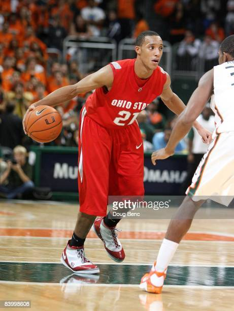 Evan Turner of the Ohio State Buckeyes drives against Brian Asbury of the Miami Hurricanes at BankUnited Center on December 2 2008 in Coral Gables...