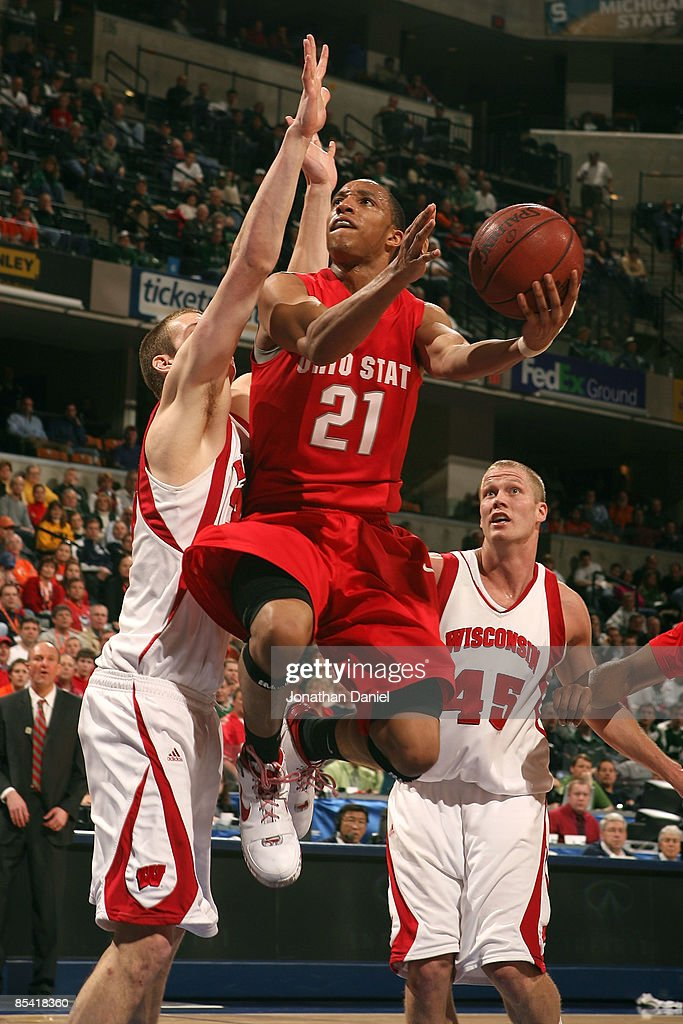 Evan Turner 21 Of The Ohio State Buckeyes Drives For A Shot Attempt Against