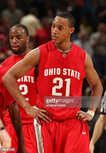 Evan Turner of the Ohio State Buckeyes looks on dejected against the Purdue Boilermakers during the final of the Big Ten Men's Basketball Tournament...