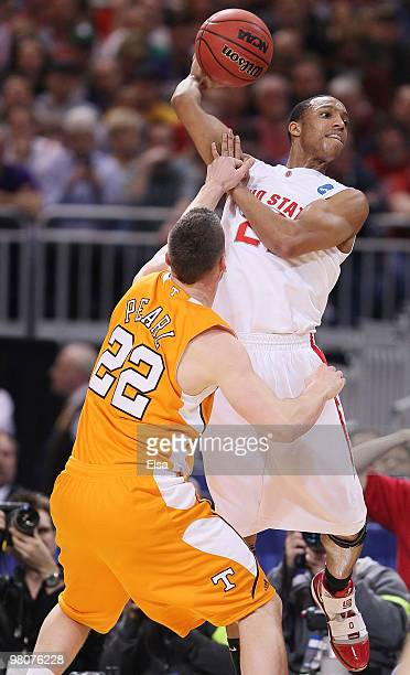 Evan Turner of the Ohio State Buckeyes tries to pass the ball as Steven Pearl of the Tennessee Volunteers defends during the midwest regional...