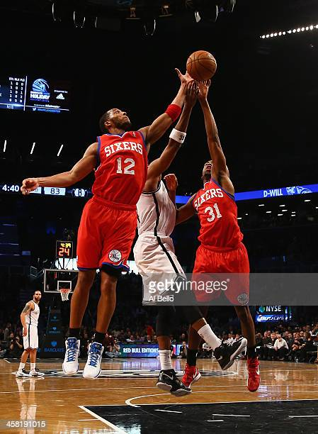 Evan Turner of the Philadelphia 76ers and Hollis Thompson in action against the Brooklyn Nets during their game at the Barclays Center on December 16...