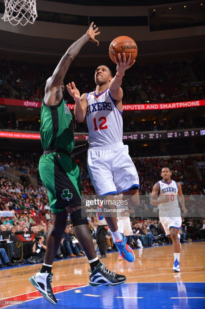 Evan Turner #12 of the Philadelphia 76ers drives to the basket against the Boston Celtics at the Wells Fargo Center on December 7, 2012 in Philadelphia, Pennsylvania.
