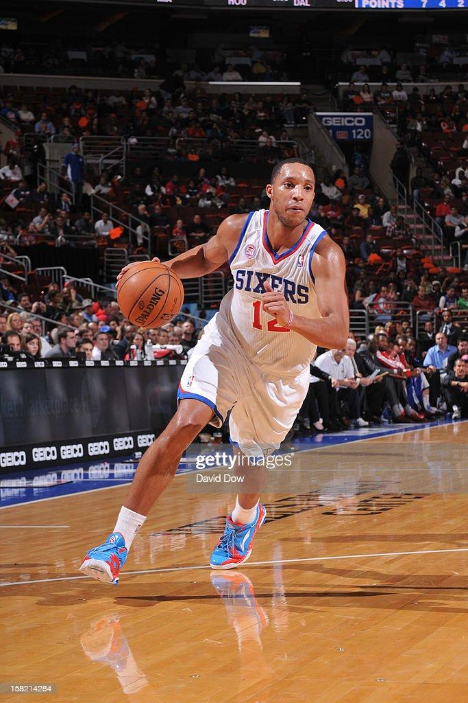 Evan Turner #12 of the Philadelphia 76ers drives to the basket against the Detroit Pistons during the game at the Wells Fargo Center on December 10, 2012 in Philadelphia, Pennsylvania.