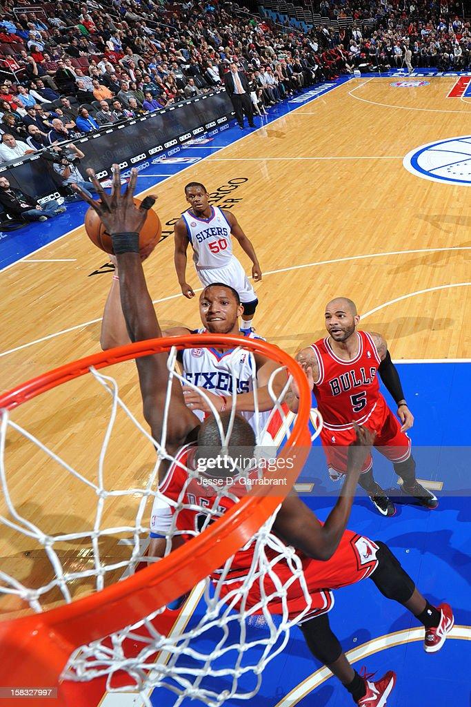 Evan Turner #12 of the Philadelphia 76ers drives to the basket against the Chicago Bulls on December 12, 2012 at the Wells Fargo Center in Philadelphia, Pennsylvania.