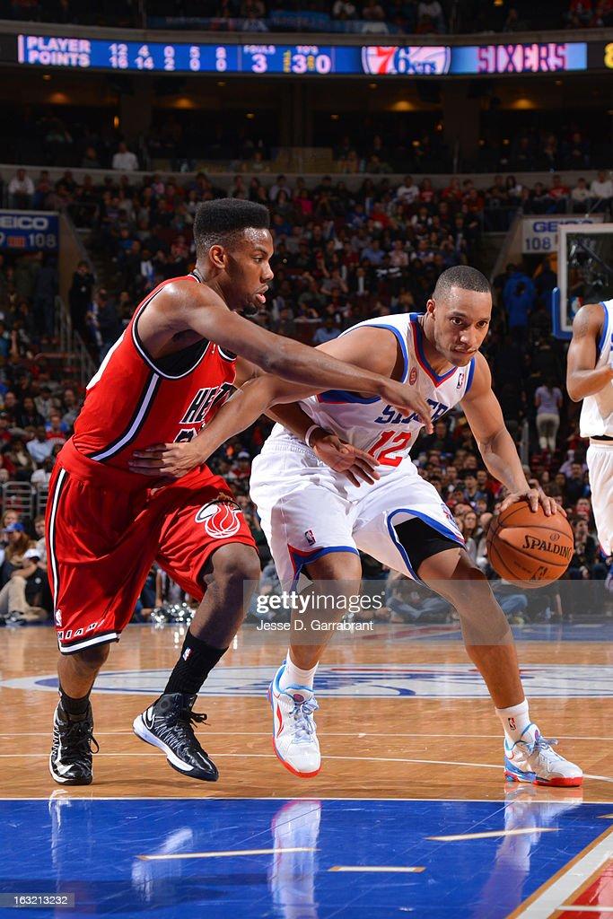 Evan Turner #12 of the Philadelphia 76ers drives to the basket against the Miami Heat at the Wells Fargo Center on February 23, 2013 in Philadelphia, Pennsylvania.