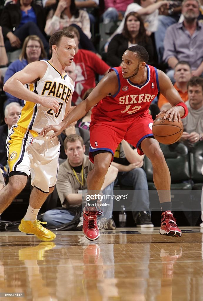 Evan Turner #12 of the Philadelphia 76ers protects the ball from Ben Hansbrough #23 of the Indiana Pacers during the game between the Indiana Pacers and the Philadelphia 76ers on April 17, 2013 at Bankers Life Fieldhouse in Indianapolis, Indiana.