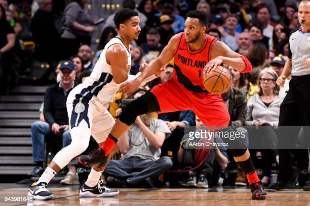 Evan Turner of the Portland Trail Blazers backs down Gary Harris of the Denver Nuggets during the first half on Monday April 9 2018