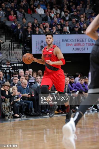 Evan Turner of the Portland Trail Blazers brings the ball up the court against the Sacramento Kings on January 1 2019 at Golden 1 Center in...