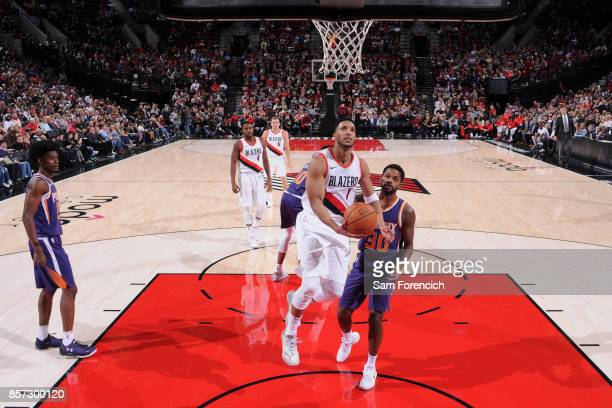 Evan Turner of the Portland Trail Blazers goes to the basket against the Phoenix Suns on October 3 2017 at the Moda Center in Portland Oregon NOTE TO...